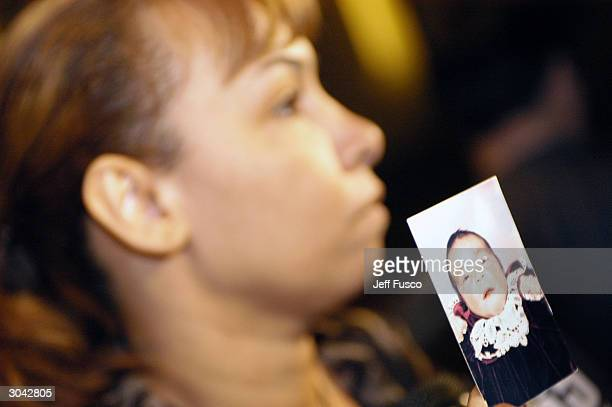 Luzaida Cuevas holding a 6yearold picture of her daughter meets with the press at city hall March 4 2004 in Philadelphia Pennsylvania Her daughter...