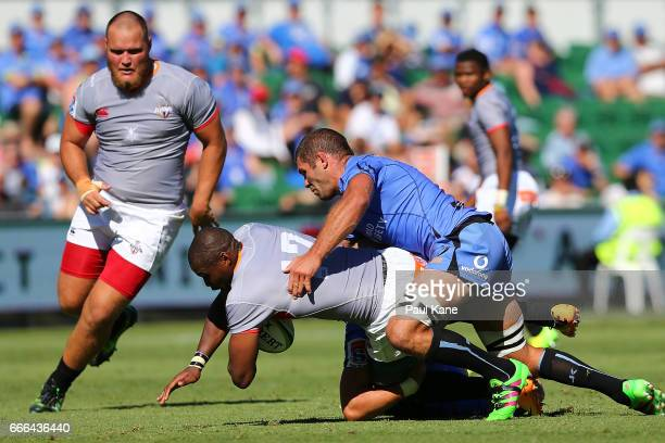 Luzuko Vulindlu of the Kings gets tackled by Matt Hodgson of the Force during the round seven Super Rugby match between the Force and the Kings at...