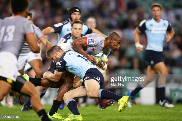 Luzuko Vulindlu of the Kings is tackled during the round nine Super Rugby match between the Waratahs and the Kings at Allianz Stadium on April 21...