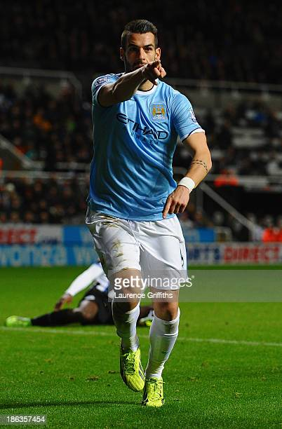 Álvaro Negredo of Manchester City celebrates scoring their first goal in extra time during the Capital One Cup Fourth Round match between Newcastle...