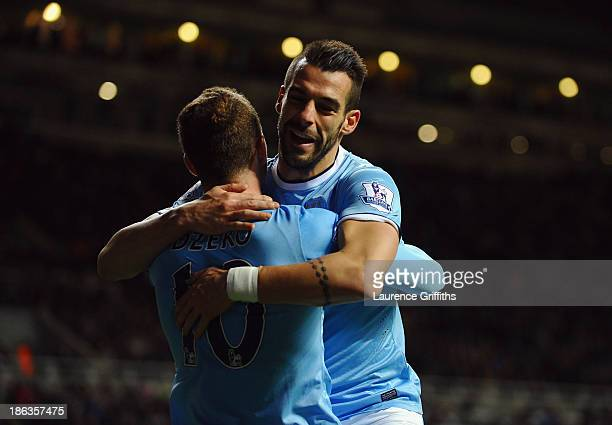 Álvaro Negredo of Manchester City celebrates scoring their first goal in extra time with Edin Dzeko of Manchester City during the Capital One Cup...