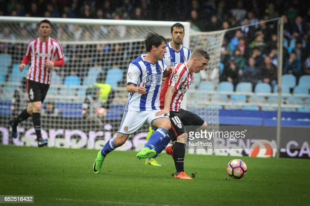 Álvaro Odriozola of Real Sociedad duels for the ball with Muniain of Athletic Club during the Spanish league football match between Real Sociedad and...