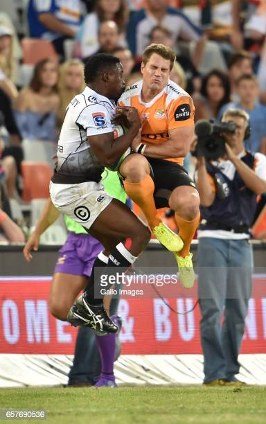 Lwazi Mvovo of the Sharks and JW Jonker of the Cheetahs during the Super Rugby match between Toyota Cheetahs and Cell C Sharks at Toyota Stadium on...