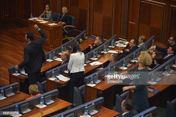 Lwmakers of the Vetvendosje opposition party throw eggs at Kosovo's Prime Minister during a parliamentary session in Pristina on September 22 2015...