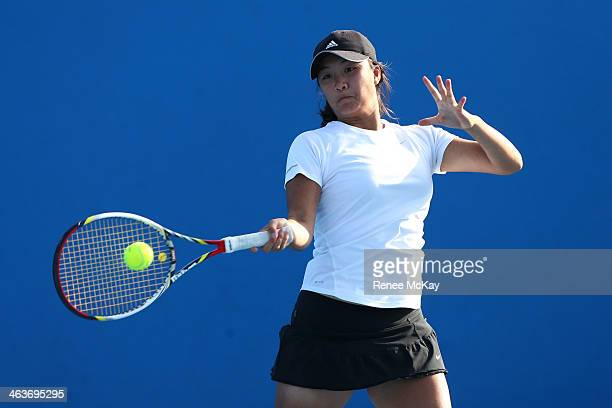 Lyann Hoang of Australia plays a forehand in her first round doubles match with Andrea Dikosavljevic of Australia against Fanny Stollar of Hungary...