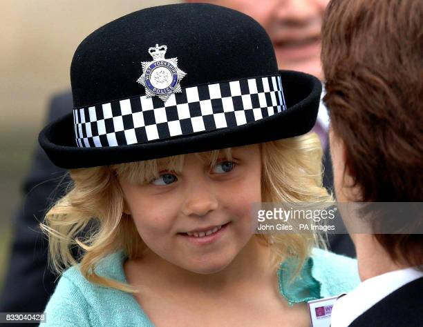 Lydia Beshenivsky five the daughter of murdered WPC Sharon Beshenivsky waits o present flowers to the Queen in Bradford today She is with WPC Cate...