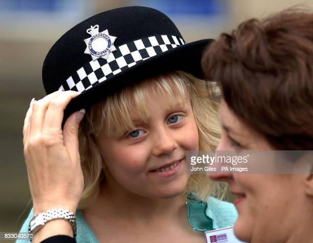 Lydia Beshenivsky five the daughter of murdered WPC Sharon Beshenivsky waits to present flowers to the Queen in Bradford today WPC Cate Jackson helps...