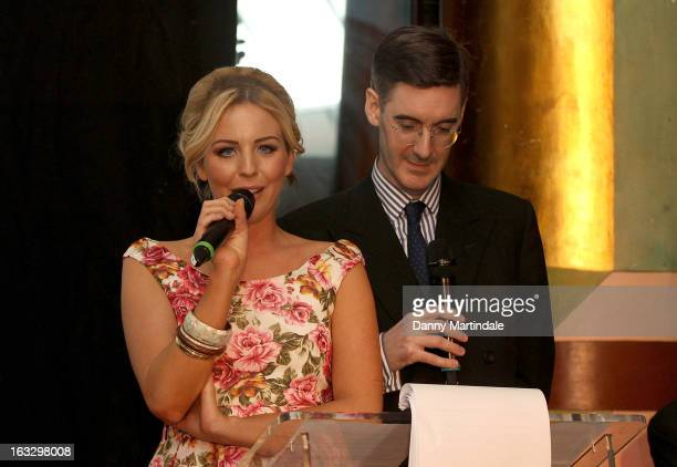 Lydia Bright and Jacob ReesMogg MP present round called 'The Only Way is Eton' at The Ultimate News Quiz 2013 for Action for Children and Restless...