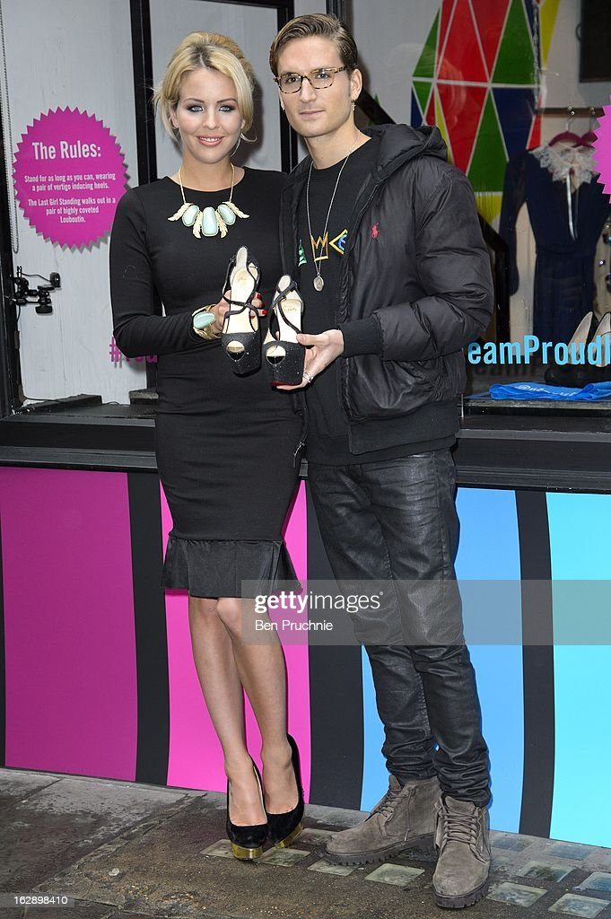 Lydia Bright (L) and Oliver Proudlock attend a photocall as girls compete to win a pair of Christian Louboutin shoes on March 1, 2013 in London, England.