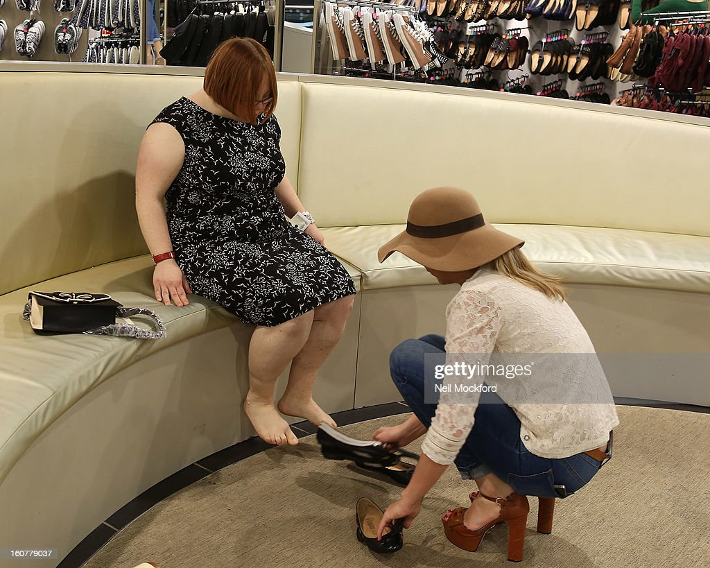 Lydia Bright (R) gives Kate Brackley from 'The Undateables' a makeover at New Look, Oxford St on February 5, 2013 in London, England.