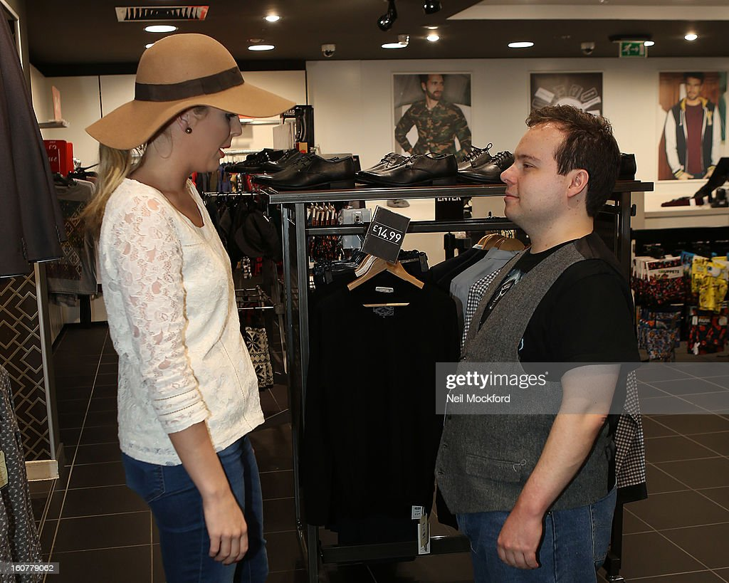 Lydia Bright gives Simon Macgregor from 'The Undateables' a makeover at New Look, Oxford St on February 5, 2013 in London, England.
