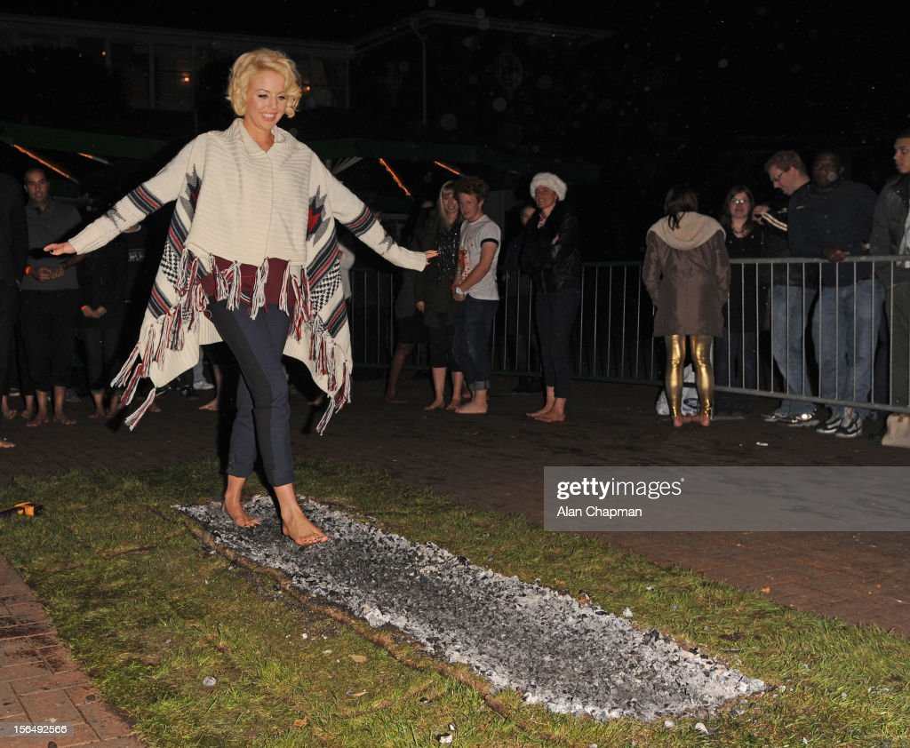 Lydia Bright walks the Fire Walk at ZSL London Zoo to raise money for Tigers on November 15, 2012 in London, England. In A statement, Lydia Bright said: 'I love animals so when I heard London Zoo were doing a fire walk to raise money for tigers I was really keen to take part. I was nervous about walking across hot coals but actually really enjoyed it, and it was for a great cause.'