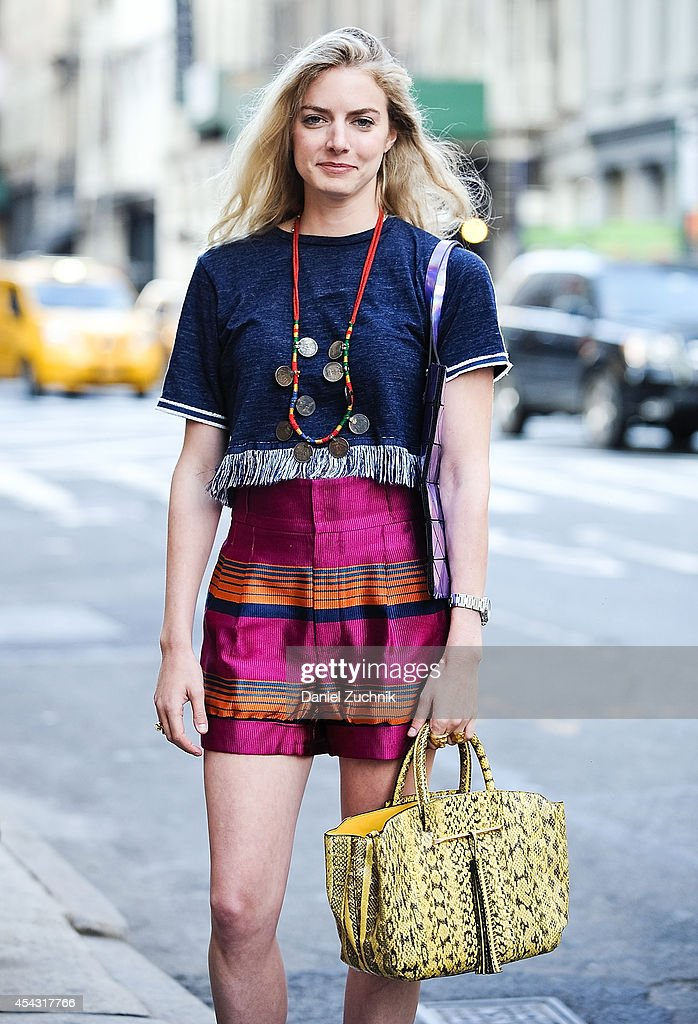 Lydia Gidwitz is seen around Soho wearing Marc Jacobs shorts a Brian Atwood bag and a vintage necklace from India on August 28, 2014 in New York City.