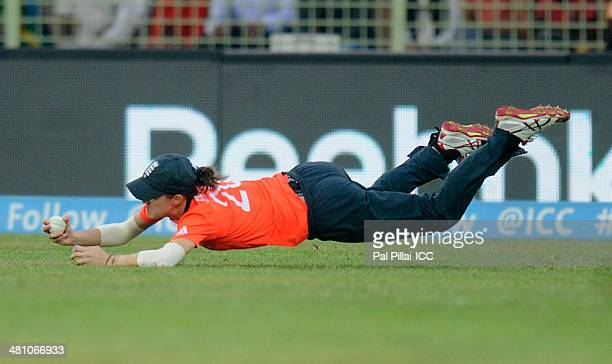 Lydia Greenway of England completes a catch to get the wicket of Salma Khatun of Bangladesh during the ICC Women's World Twenty20 match between...