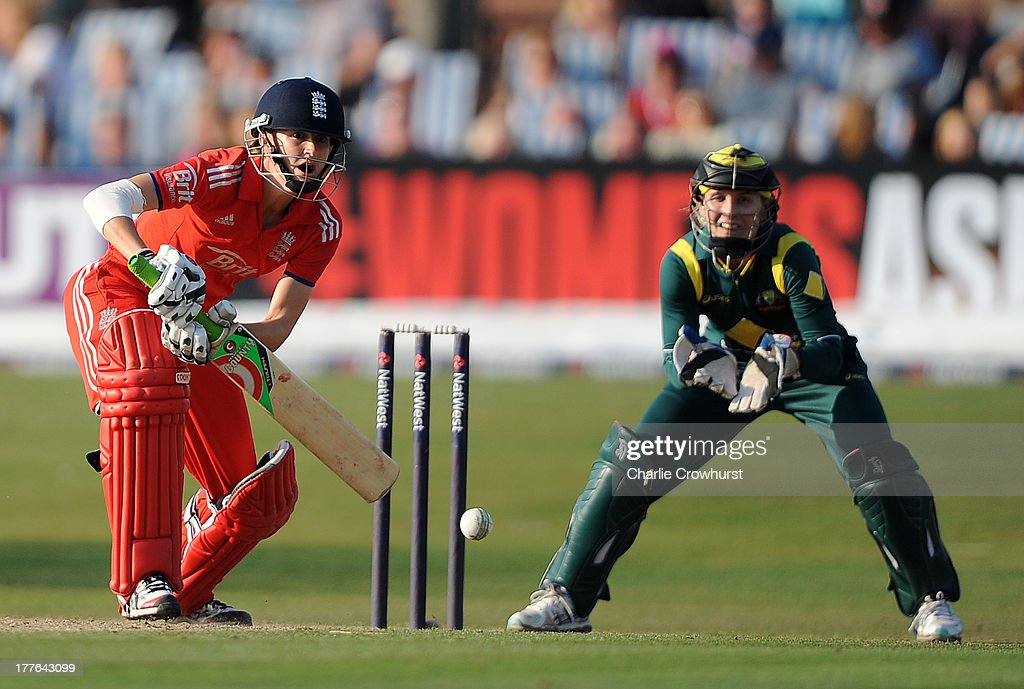 Lydia Greenway of England eyes up a shot with Australia's <a gi-track='captionPersonalityLinkClicked' href=/galleries/search?phrase=Jodie+Fields&family=editorial&specificpeople=5576479 ng-click='$event.stopPropagation()'>Jodie Fields</a> looks on during the England Women and Australia Women Ashes Series - 3rd NatWest ODI at The BrightonandHoveJobs.com County Ground on August 25, 2013 in Hove, England.