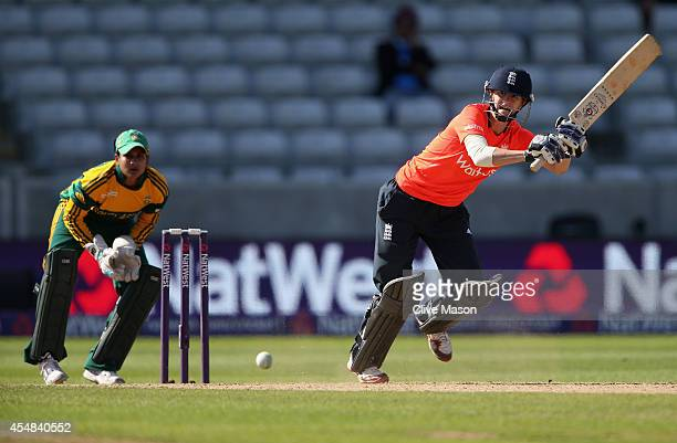 Lydia Greenway of England in action batting as Trisha Chetty of South Africa looks on during the NatWest Women's International T20 match between...