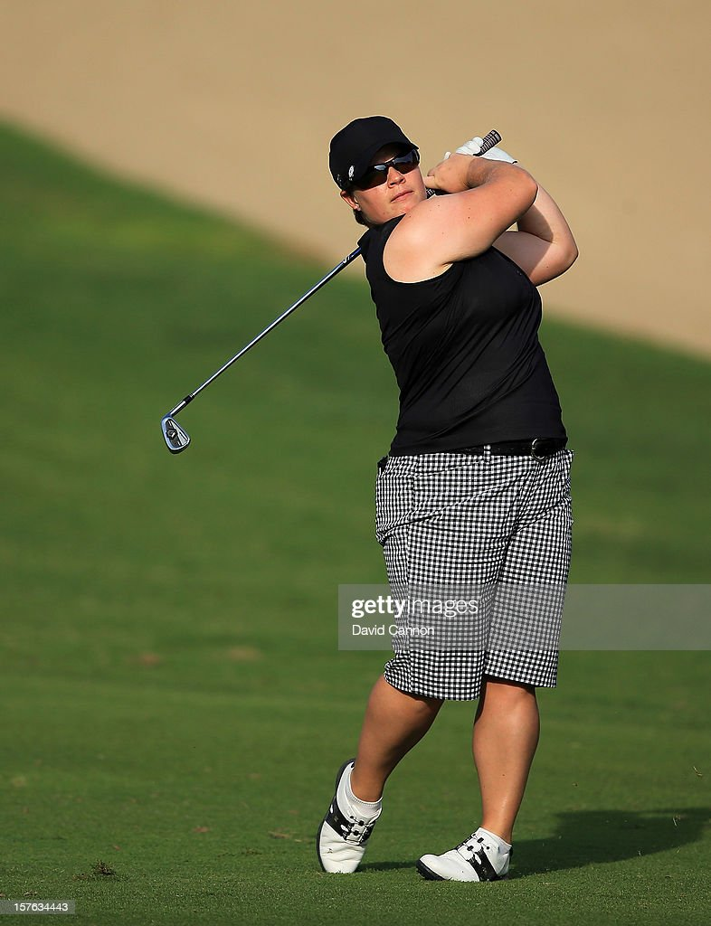 Lydia Hall of Wales plays her second shot at the par 4, 14th hole during the first round of the 2012 Omega Dubai Ladies Masters on the Majilis Course at the Emirates Golf Club on December 5, 2012 in Dubai, United Arab Emirates.