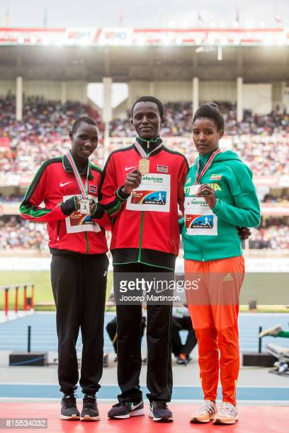 Lydia Jeruto Lagat and Jackline Wambui of Kenya and Hirut Meshesha of Ethiopia pose in the girls 800m medal ceremony during day 5 of the IAAF U18...