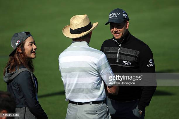 Lydia Ko golf coach David Leadbetter and Henrik Stenson of Sweden talk on the range during a practice round prior to the start of the 2016 Masters...