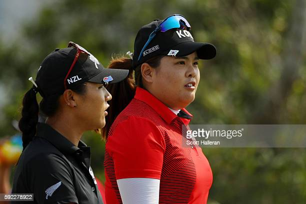 Lydia Ko of New Zealand and Inbee Park of Korea walk on the seventh hole during the Women's Golf Final on Day 15 of the Rio 2016 Olympic Games at the...