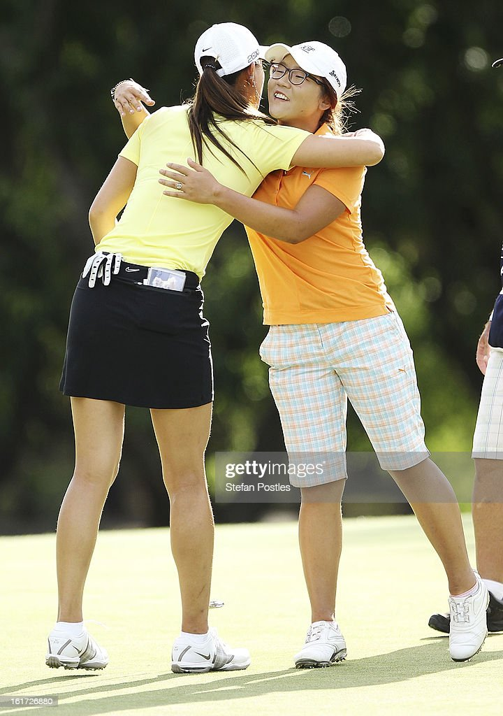 Lydia Ko of New Zealand and Michelle Wie hug after completing their round during day two of the ISPS Handa Australian Open at Royal Canberra Golf Club on February 15, 2013 in Canberra, Australia.