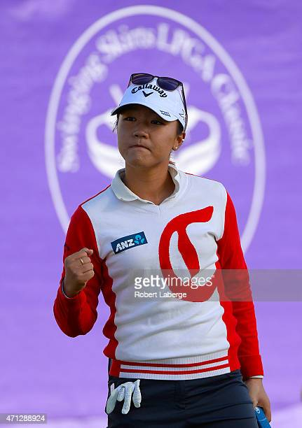 Lydia Ko of New Zealand celebrates making a birdie putt on the 18th hole to tie for the lead during the final round the Swinging Skirts LPGA Classic...