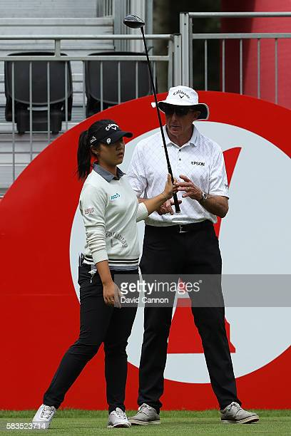 Lydia Ko of New Zealand chats to her Coach David Leadbetter during a ProAm round ahead of the Ricoh Women's British Open at Woburn Golf Club on July...