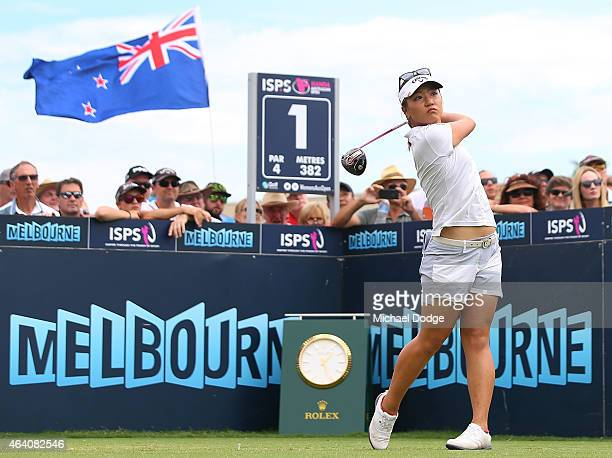 Lydia Ko of New Zealand hits a tee shot on the first hole in front a New Zealand flag held by a fan during day four of the LPGA Australian Open at...