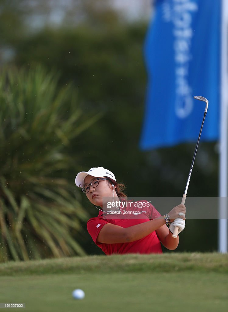 Lydia Ko of New Zealand hits balls from a bunker during her warm up in preparation for day three of the New Zealand Women's Golf Open at Clearwater Golf Course on February 10, 2013 in Christchurch, New Zealand.