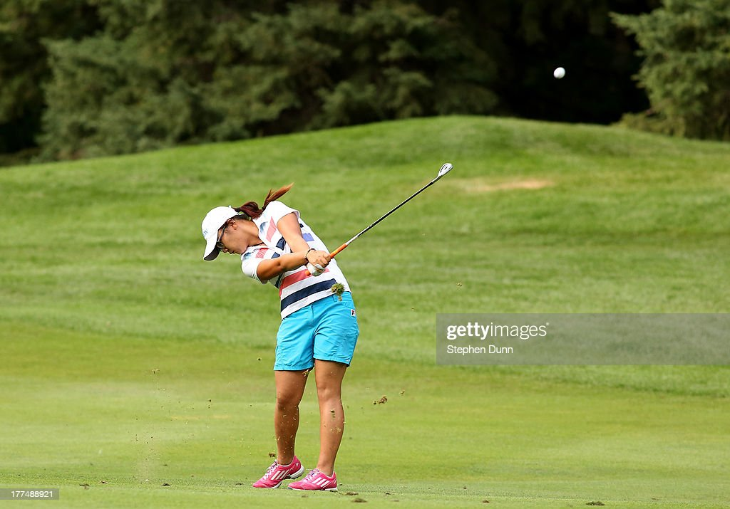 <a gi-track='captionPersonalityLinkClicked' href=/galleries/search?phrase=Lydia+Ko&family=editorial&specificpeople=5817103 ng-click='$event.stopPropagation()'>Lydia Ko</a> of New Zealand hits her second shot on the ninth hole during the second round of the CN Canadian Women's Open at Royal Mayfair Golf Club on August 23, 2013 in Edmonton, Alberta, Canada.