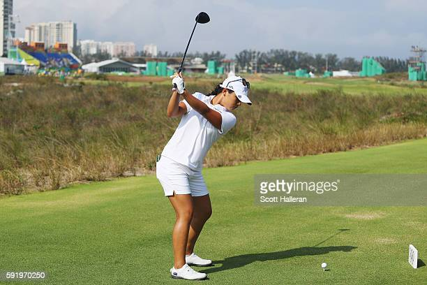 Lydia Ko of New Zealand hits her tee shot on the 18th hole during the third round of the Women's Individual Stroke Play golf on Day 14 of the Rio...