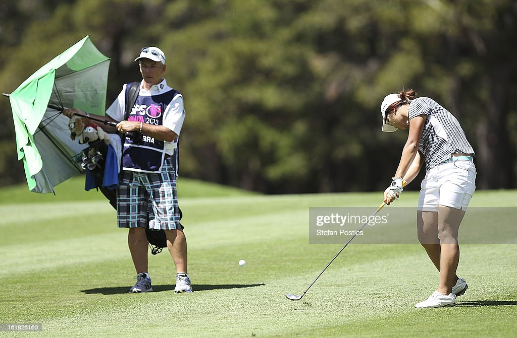 <a gi-track='captionPersonalityLinkClicked' href=/galleries/search?phrase=Lydia+Ko&family=editorial&specificpeople=5817103 ng-click='$event.stopPropagation()'>Lydia Ko</a> of New Zealand hits up the fairway of the 5th hole during day four of the ISPS Handa Australian Open at Royal Canberra Golf Club on February 17, 2013 in Canberra, Australia.