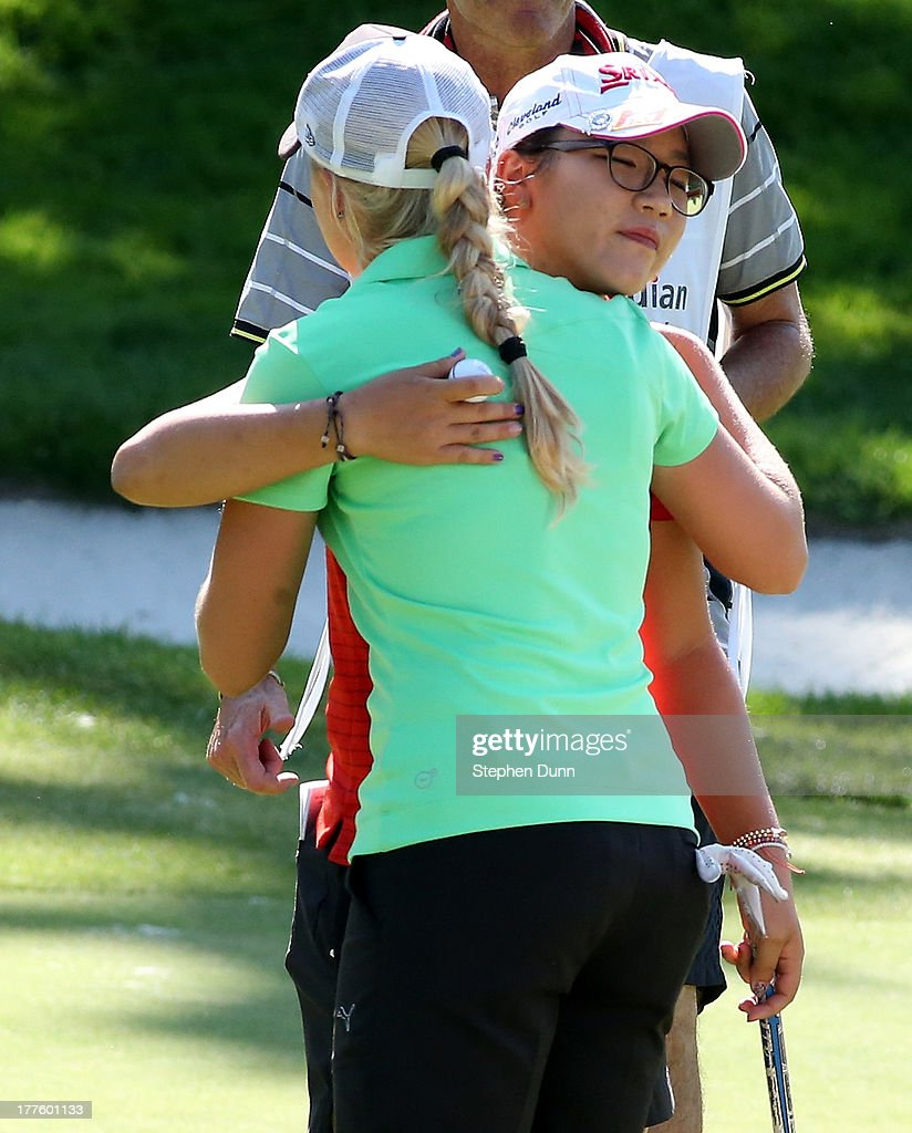 <a gi-track='captionPersonalityLinkClicked' href=/galleries/search?phrase=Lydia+Ko&family=editorial&specificpeople=5817103 ng-click='$event.stopPropagation()'>Lydia Ko</a> of New Zealand (R) hugs <a gi-track='captionPersonalityLinkClicked' href=/galleries/search?phrase=Charley+Hull&family=editorial&specificpeople=7118530 ng-click='$event.stopPropagation()'>Charley Hull</a> of England after they finish their round during the third round of the CN Canadian Women's Open at Royal Mayfair Golf Club on August 24, 2013 in Edmonton, Alberta, Canada.