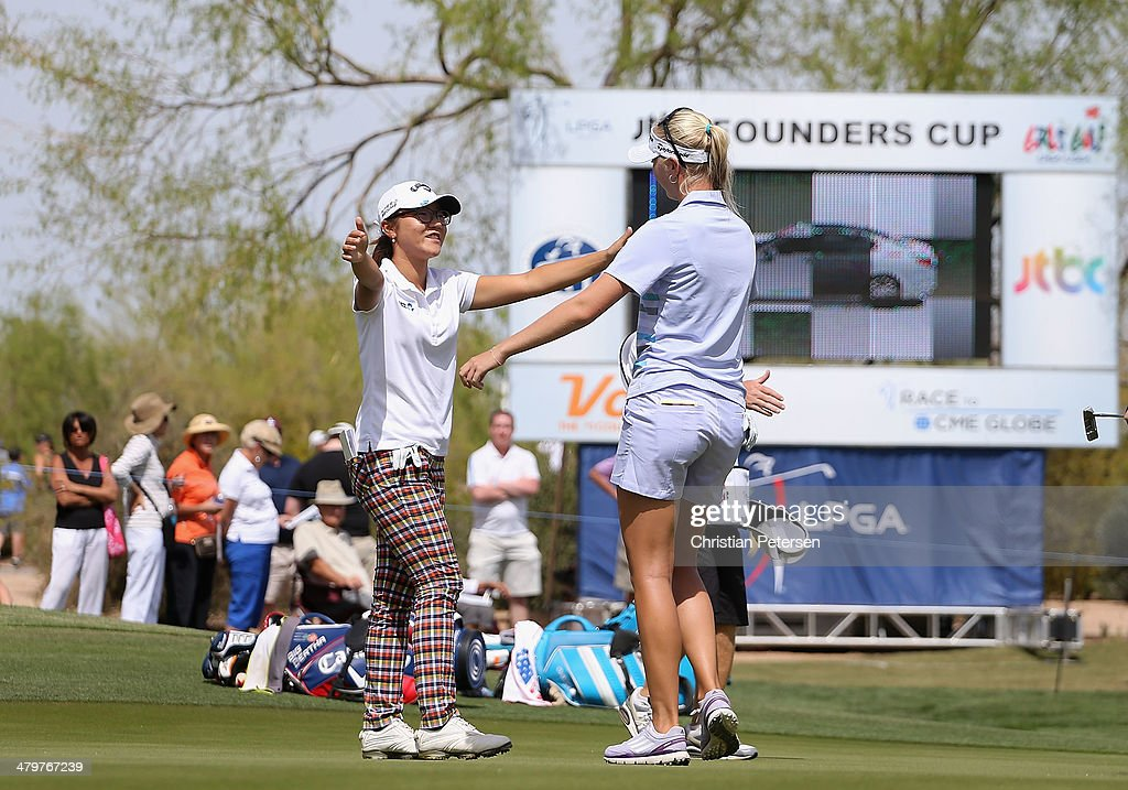 Lydia Ko (L) of New Zealand hugs Jessica Korda on the ninth green following the first round of the JTBC LPGA Founders Cup at Wildfire Golf Club on March 20, 2014 in Phoenix, Arizona.