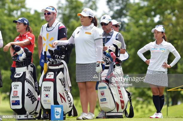 Lydia Ko of New Zealand Inbee Park of Korea and Ai Miyazato of Japan wait on the third tee box during the second round of the Walmart NW Arkansas...