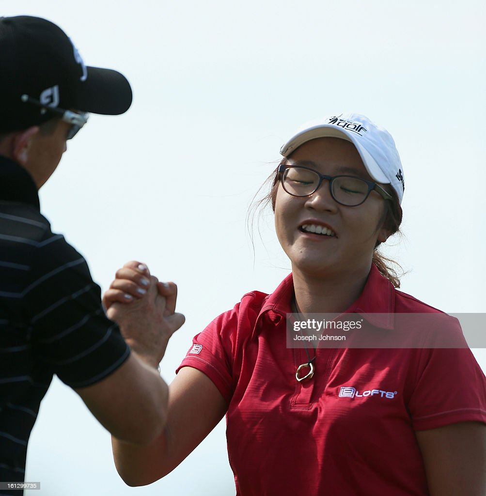 <a gi-track='captionPersonalityLinkClicked' href=/galleries/search?phrase=Lydia+Ko&family=editorial&specificpeople=5817103 ng-click='$event.stopPropagation()'>Lydia Ko</a> of New Zealand is congratulated by her coach Guy Wilson after winning the New Zealand Women's Golf Open at Clearwater Golf Course on February 10, 2013 in Christchurch, New Zealand.