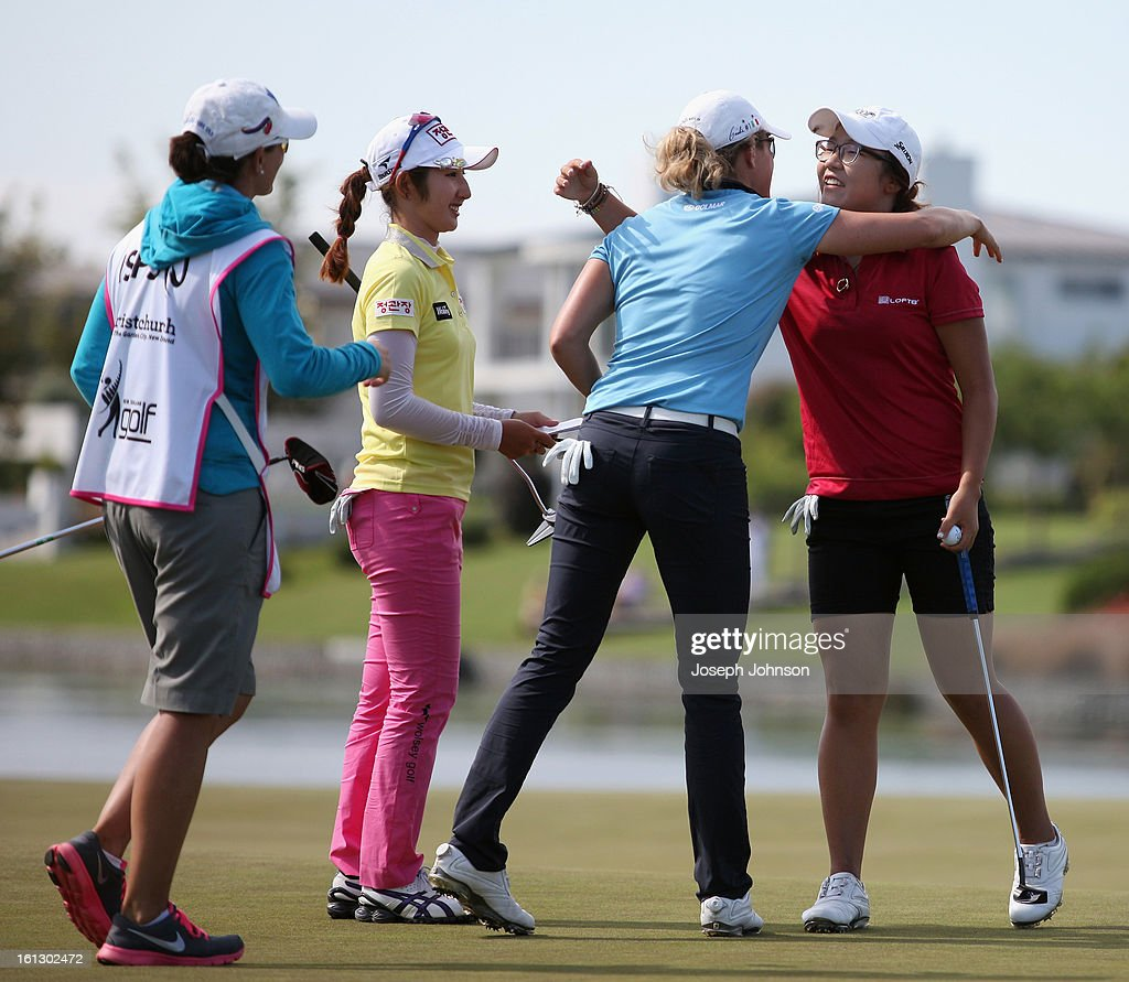<a gi-track='captionPersonalityLinkClicked' href=/galleries/search?phrase=Lydia+Ko&family=editorial&specificpeople=5817103 ng-click='$event.stopPropagation()'>Lydia Ko</a> of New Zealand (R) is congratulated by her playing partner Giulia Sergas of Italy and walking in Seon Woo Bae of Korea after Lydia won the New Zealand Women's Golf Open at Clearwater Golf Course on February 10, 2013 in Christchurch, New Zealand.