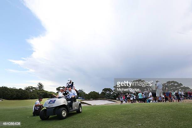 Lydia Ko of New Zealand is driven off in a buggy at the 9th hole after play was post poned due to storm activity close by during day four of the LPGA...