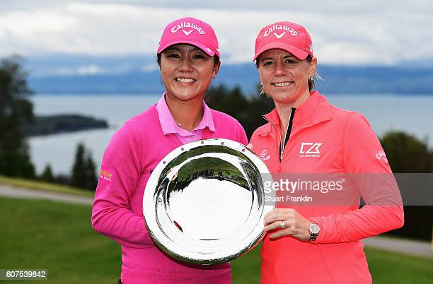 Lydia Ko of New Zealand is presented with the Rolex Annika Major Award by Annika Sörenstam of Sweden after the final round of The Evian Championship...