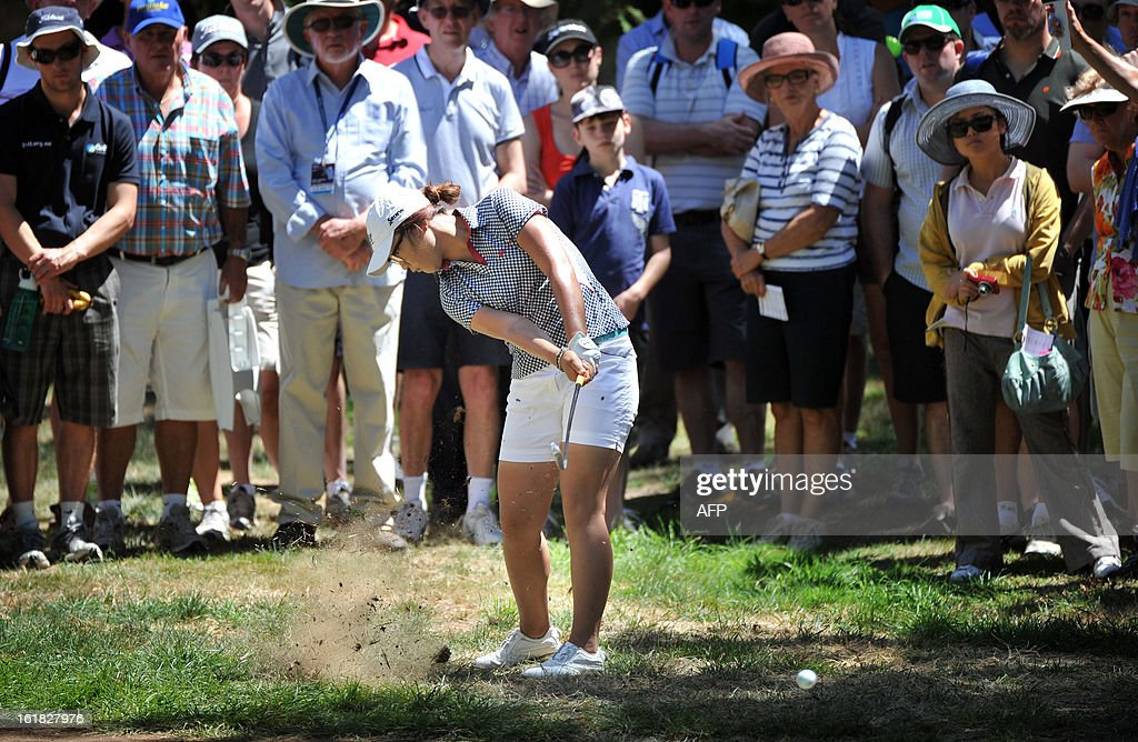 Lydia Ko of New Zealand plays a shot during the final round of the Women's Australian Open golf tournament in Canberra on February 17, 2013. AFP PHOTO / MARK GRAHAM -- IMAGE RESTRICTED TO EDITORIAL USE - STRICTLY NO COMMERCIAL USE