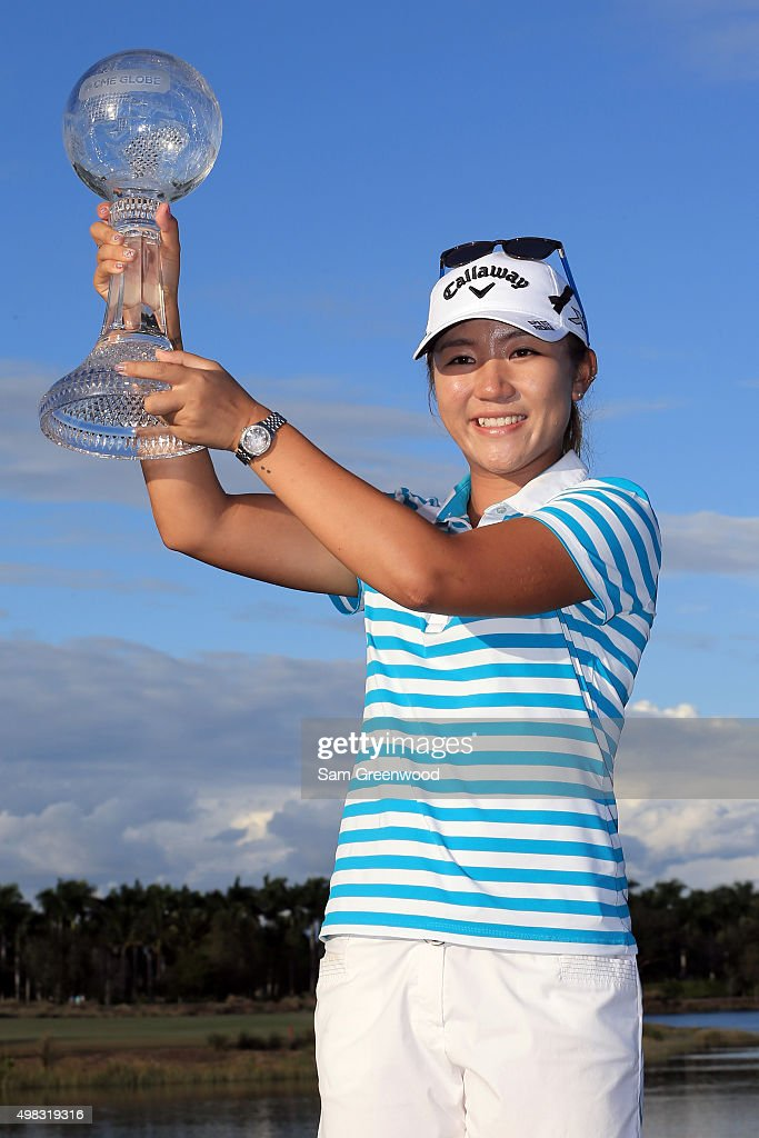 Lydia Ko of New Zealand poses with the CME Race for the Globe trophy during the final round of the CME Group Tour Championship at Tiburon Golf Club on November 22, 2015 in Naples, Florida.