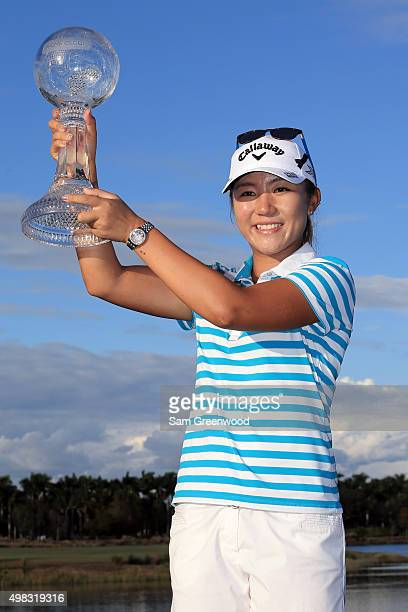 Lydia Ko of New Zealand poses with the CME Race for the Globe trophy during the final round of the CME Group Tour Championship at Tiburon Golf Club...