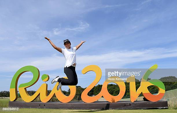 Lydia Ko of New Zealand poses with the Rio 2016 sing during a practice round prior to the Women's Individual Stroke Play golf at the Olympic Golf...