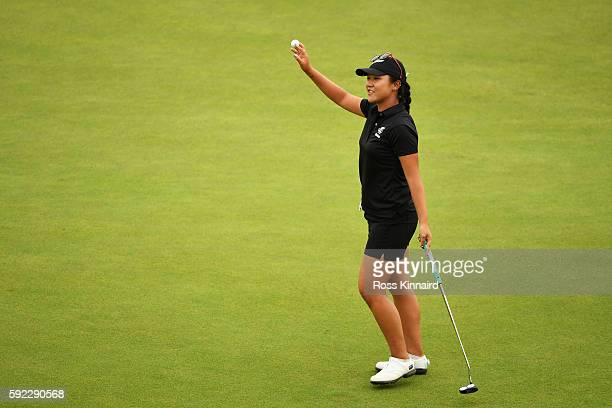 Lydia Ko of New Zealand reacts after putting for birdie on the 18th green to win silver during the Women's Golf Final on Day 15 of the Rio 2016...