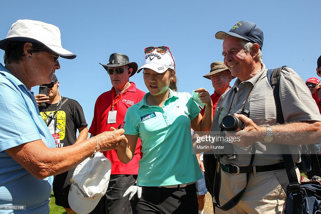 <a gi-track='captionPersonalityLinkClicked' href=/galleries/search?phrase=Lydia+Ko&family=editorial&specificpeople=5817103 ng-click='$event.stopPropagation()'>Lydia Ko</a> (C) of New Zealand signs autographs after her 1st round of the New Zealand Women's Open at Clearwater Golf Club on February 12, 2016 in Christchurch, New Zealand.