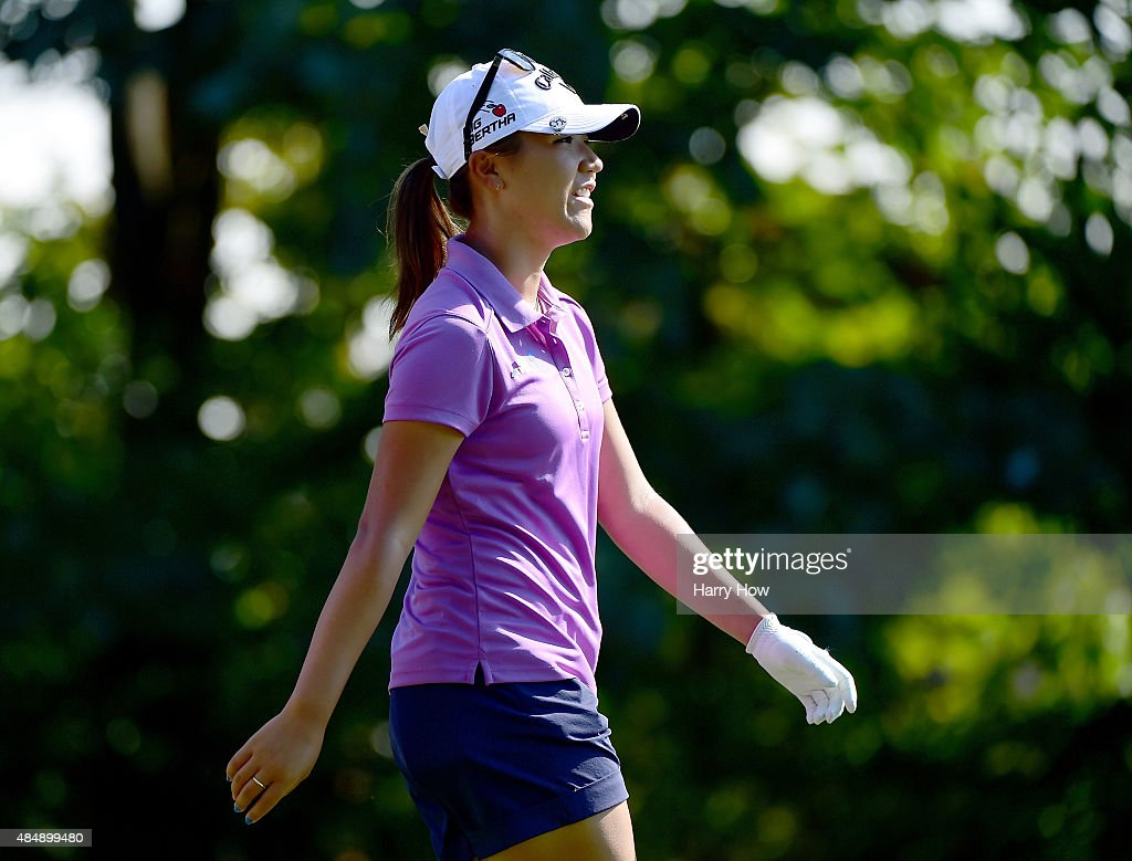 Lydia Ko of New Zealand smiles as she walks down the fairway of the 6th hole during the third round of the Canadian Pacific Women's Open at the Vancouver Golf Club on August 22, 2015 in Vancouver, Canada.