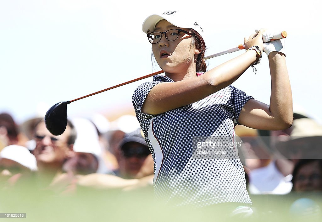 <a gi-track='captionPersonalityLinkClicked' href=/galleries/search?phrase=Lydia+Ko&family=editorial&specificpeople=5817103 ng-click='$event.stopPropagation()'>Lydia Ko</a> of New Zealand tee's of the 1st tee during day four of the ISPS Handa Australian Open at Royal Canberra Golf Club on February 17, 2013 in Canberra, Australia.