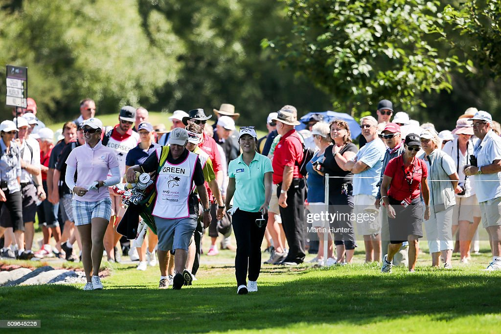 <a gi-track='captionPersonalityLinkClicked' href=/galleries/search?phrase=Lydia+Ko&family=editorial&specificpeople=5817103 ng-click='$event.stopPropagation()'>Lydia Ko</a> (C) of New Zealand walks the 9th fairway during the 1st round of the New Zealand Women's Open at Clearwater Golf Club on February 12, 2016 in Christchurch, New Zealand.