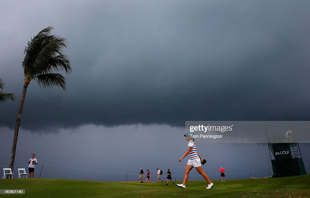 <a gi-track='captionPersonalityLinkClicked' href=/galleries/search?phrase=Lydia+Ko&family=editorial&specificpeople=5817103 ng-click='$event.stopPropagation()'>Lydia Ko</a> of New Zealand walks to the 18th tee as a storm approaches during round one of the Pure Silk Bahamas LPGA Classic at the Ocean Club course on February 5, 2015 in Paradise Island, Bahamas.