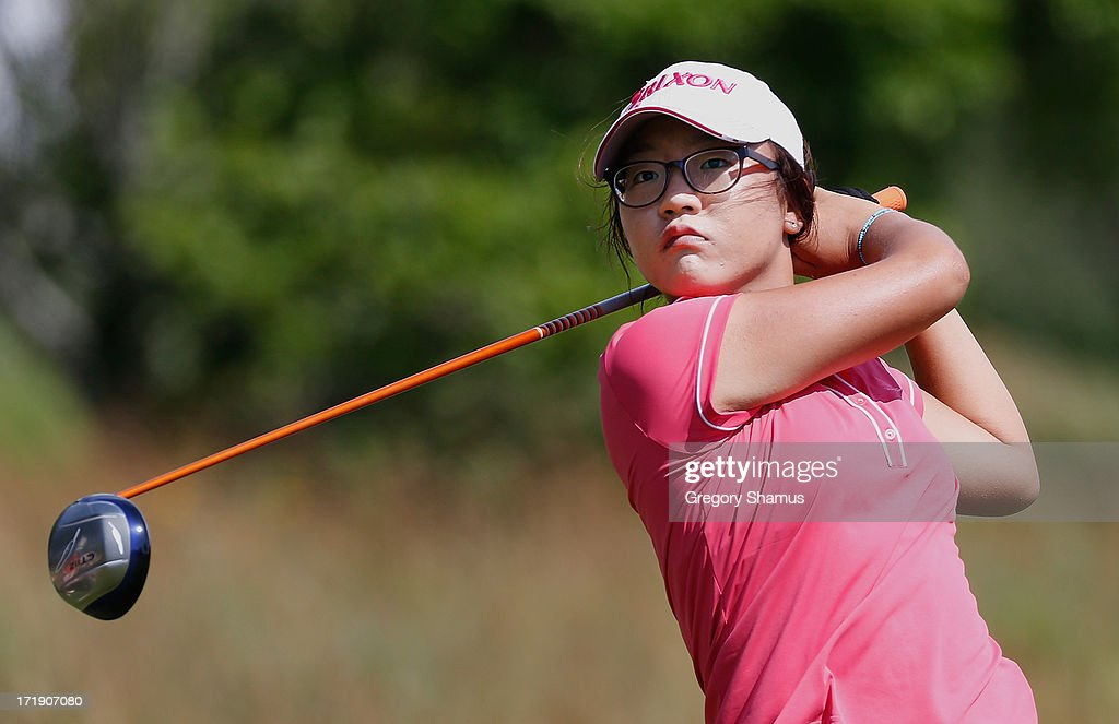 <a gi-track='captionPersonalityLinkClicked' href=/galleries/search?phrase=Lydia+Ko&family=editorial&specificpeople=5817103 ng-click='$event.stopPropagation()'>Lydia Ko</a> of New Zealand watches her tee shot on the eighth hole during the third round of the 2013 U.S. Women's Open at Sebonack Golf Club on June 29, 2013 in Southampton, New York.